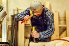 Experienced carpenter in workshop stock photos