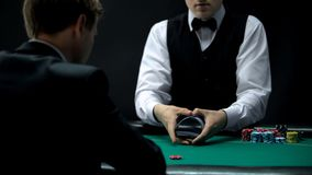 Experienced casino croupier making shuffling tricks with cards, chance to win. Stock photo royalty free stock photos