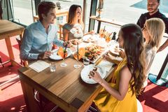 Experienced chef congratulated by four people at a trendy exclusive restaurant Royalty Free Stock Photography