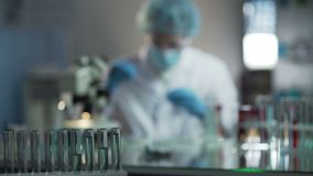 Experienced chemists developing high-quality cosmetics in cosmetology laboratory. Stock footage stock video