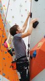 Experienced Climber Challenging Wall Obstacles Stock Photo