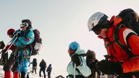 Experienced climbers stopped for a rest, relax and reflect as they go upstairs. Special glasses, helmet, backpacks stock video footage