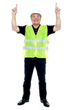 Experienced construction employee pointing his fingers upwards Stock Image