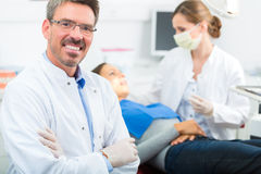 Experienced Dentist in his surgery Royalty Free Stock Image