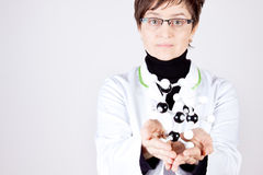 Experienced Doctor. Holding molecules on white Stock Photography