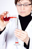 Experienced Doctor. Experimenting with flasks on white Royalty Free Stock Image