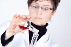 Experienced Doctor. Experimenting with flasks on white Stock Photo