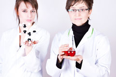 Experienced Doctor and assistant Royalty Free Stock Image