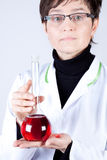 Experienced Doctor with Flask. Experienced Doctor holding flask on white Stock Photos