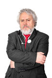 Experienced doctor. A gray haired and bearded doctor looking concerned stock photo