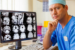 Experienced doctor with an MRI scan. Of the Brain on Monitior Royalty Free Stock Photography