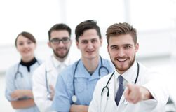 Experienced doctor showing forward. Photo with copy space royalty free stock images