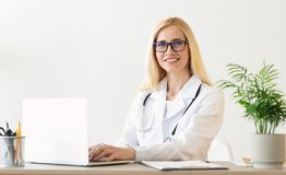 Experienced Doctor Working On Medical Expertise In Office. Experienced Doctor Working On Medical Expertise, Using Laptop In Office, free space royalty free stock photography