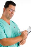 Experienced doctor writing prescriptions Royalty Free Stock Photos