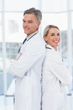 Experienced doctors posing together back to back Royalty Free Stock Photo