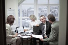 Experienced employees discussing problems in the office. royalty free stock photography