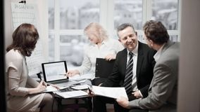 Experienced employees discussing problems in the office. royalty free stock photos