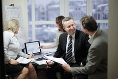 Experienced employees discussing problems in the office. The concept of teamwork royalty free stock image