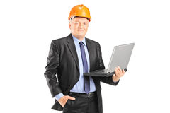 Experienced engineer posing with a laptop Royalty Free Stock Photography