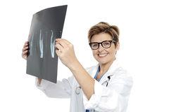 Experienced female doctor examining x-ray report stock photo