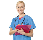 Experienced female doctor smiling at camera royalty free stock image
