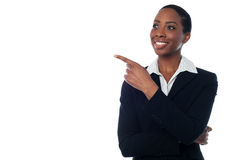 Experienced female executive pointing away Stock Photography