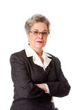 Experienced female lawyer. Experienced female business lawyer in suit. Beautiful Senior old woman with arms crossed, isolated royalty free stock photography