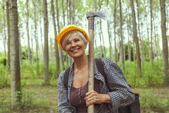 Experienced female lumberjack while visiting a forest Royalty Free Stock Images
