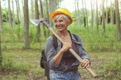 Experienced female lumberjack while visiting a forest Royalty Free Stock Image