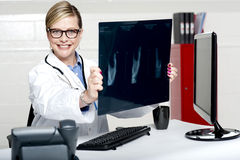 Experienced female physician holding x-ray Royalty Free Stock Image