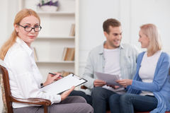 Experienced female psychologist is giving her Stock Images