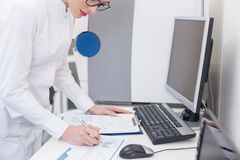 Experienced female researcher is working with papers Royalty Free Stock Photo