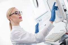 Experienced female scientist is doing her research Royalty Free Stock Image