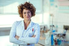 Experienced female scientist in laboratory. Looking at camera royalty free stock image