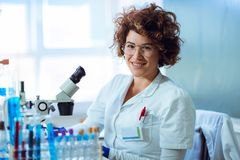 Experienced female scientist is working in laboratory. Royalty Free Stock Image