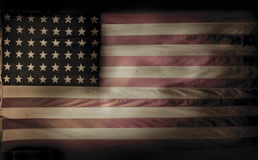An Experienced Flag. This American flag has served it's country and it's faded and worn body is now retired Royalty Free Stock Photography
