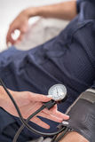Experienced general practitioner measuring male pressure stock photo