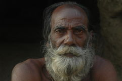 EXPERIENCED INDIAN FARMER. AN EXPERIENCED INDIAN FARMER LOOKS WORRIED ABOUT THEIR FUTURE Royalty Free Stock Photo