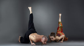 Experienced instructors posing while doing asana Royalty Free Stock Photography