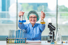 The experienced lab assistant working on chemical solutions Stock Images