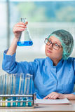 The experienced lab assistant working on chemical solutions Royalty Free Stock Image