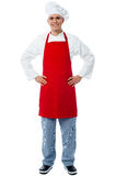 Experienced male chef posing casually Royalty Free Stock Images