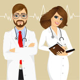 Experienced male and female doctors Royalty Free Stock Images