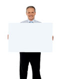 Experienced male representative with ad board stock photos