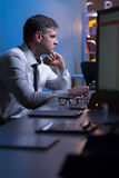 Experienced manager in the office. Experienced manager is working after hours in the office stock image