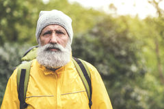 Experienced mature male tourist traveling in wild nature royalty free stock photo