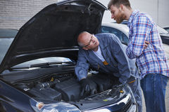 Experienced mechanic with client Stock Images