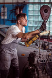 Experienced mechanic in shop. Experienced young mechanic in car repair shop stock image