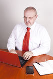 Experienced office boss by the desk. Royalty Free Stock Images
