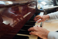 Experienced old hands closeup playing  piano Royalty Free Stock Photography